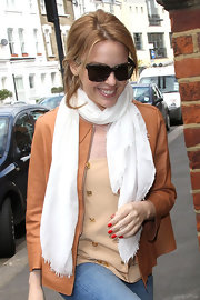 Kylie Minogue was spotted out in London sporting bright tomato-red nail polish on both her fingers and toes.