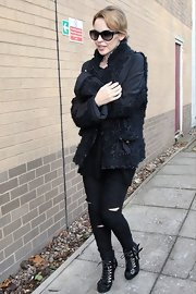 Kylie Minogue laced up her black ankle boots before heading to her London recording studio.