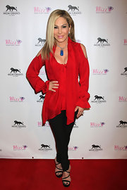 Adrienne Maloof looked snazzy in a red blouse with shoulder cutouts at the opening of Blizz Frozen Yogurt.