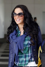 Tulisa Contostavlos wore her long dark tresses in bouncy curls while in Los Angeles.