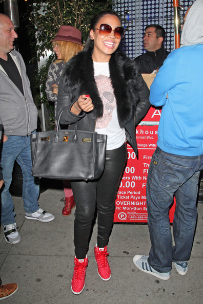 La La Anthony Leather Pants