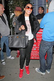 La La Anthony was edgy-glam in her black leather-on-leather pants and jacket combo during a dinner out at Boa Steakhouse.