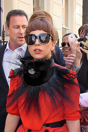 Gaga hit her eyes behind a big pair of cat-eye sunnies.