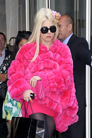 Lady Gaga shops around NYC wearing her hair in a retro bouffant adorned with pretty pink flowers.