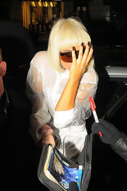 Lady Gaga has some ferocious sharp nails painted in a dark polish.  Dramatic!