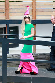 Lady Gaga opted for simple black suede platform pumps to top off her vibrant outfits.