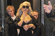 Always attention seeking singer Lady Gaga took to the streets of New York in a breast baring outfit as she was seen leaving her hotel.