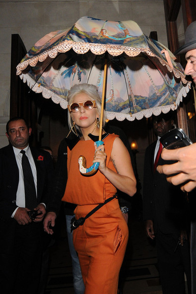 Lady Gaga stepped out in London carrying a painterly mermaid umbrella by Tsumori Chisato.