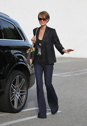 Laeticia Hallyday sharpened her street style with a tailored black blazer.