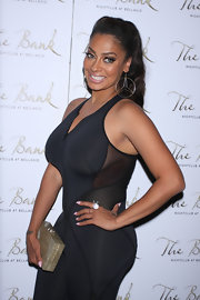 La La Anthony's mother-of-pearl box clutch was an elegant contrast the her sporty jumpsuit during her birthday party.