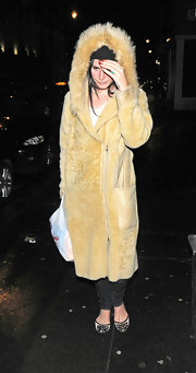 Lana Del Rey sported this camel-colored fur coat while out shopping late in London.