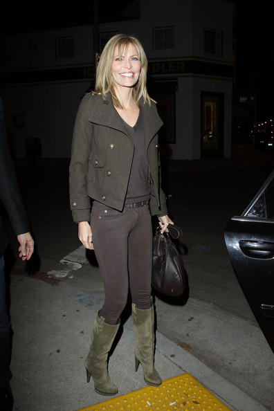 Shawn King donned suede olive knee high boots. The earth tone footwear was the perfect complement to her monochromatic outfit.