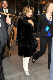 La Toya Jackson chose a black velvet evening coat for her glamorous look while hitting the NYC streets.