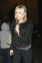 Laura Whitmore looked flamboyant in a black fur vest and a spiked hairband while out clubbing in London.