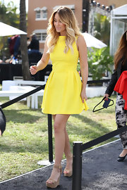 Lauren Conrad looked bright and ready for spring in a yellow day dress with a pleated A-line skirt.