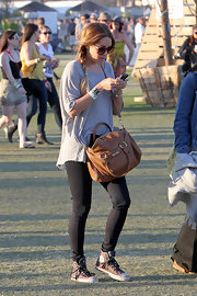 Lauren Conrad looked casual and comfortable at the Coachella Music Festival wearing a pair of striped canvas Chuck Taylors.
