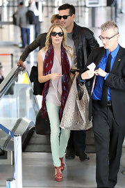 LeAnn Rimes brightened up her travel attire with mauve Napa washed T-strap platforms.