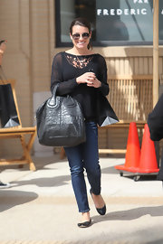 Lea Michele stuck to a casual daytime look with this black loose-fitting blouse.