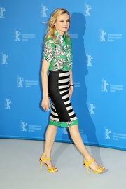 Diane Kruger opted for colorful kicks, wearing bright yellow sandals.