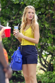 Blake paired her sunny yellow top with navy, pinstriped shorts.