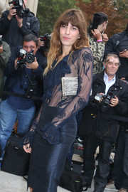 Lou Doillon arrived for the Chanel fashion show carrying an ultra-chic metallic silver clutch from the brand.