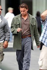 Leonardo DiCaprio looked a little rugged in his olive corduroy jacket, polo shirt, and jeans on the set of 'Inception.'