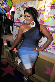 Lil' Kim hit the milkshake spot sporting a curve-hugging blue bandage dress.