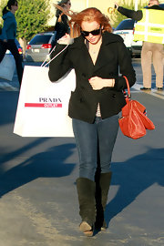 Lindsay wears a black pea coat while out shopping at the Prada outlet.