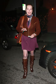 Lisa Niemi went out to eat wearing brown leather knee high boots. She paired the cold weather essentials with a brown zip up jacket and colorful silk scarf.