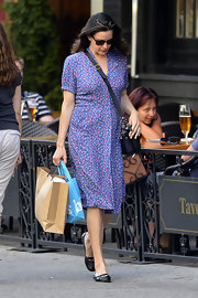Liv's pretty purple shirt dress featured delicate patterns that gave her look a touch of retro flare.
