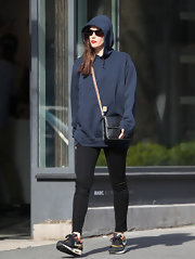 Liv Tyler chose a navy blue hoodie for her casual daytime look while roaming the streets of NYC.