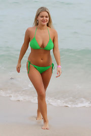Yulia Voronin showed off her voluptuous figure in a green string bikini.