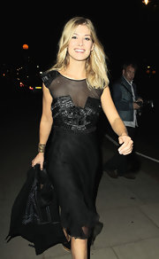 Actress Rosamund Pike proves that a little black dress need not be dull in this dramatic Fall 2010 frock.