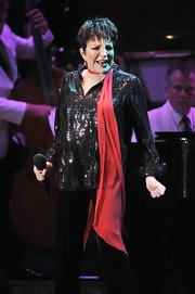 Liza Minnelli added a splash of color to her all black outfit by tying a red silk scarf around her neck.