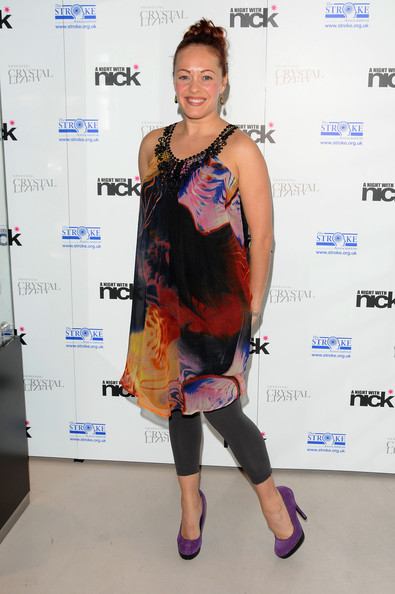 Sarah paired a colorful frock with purple suede platforms. The lovely heels feature contrasting black platforms.