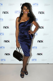 Sinitta showed off a pair of metallic blue platform sandals at a Swarovski crystal event. The navy heels complemented a matching satin one shoulder dress.