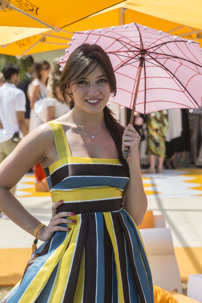 Daisy Lowe was spotted at the Veuve Clicquot Gold Cup Final carrying a cute striped umbrella with pompom embellishments.