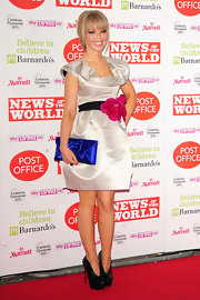 Katie Piper hit the red carpet in style in a sweet ivory cocktail dress with a rosette-adorned belt.