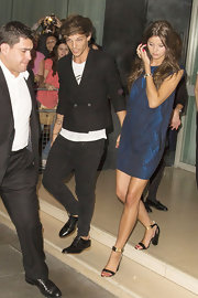 Eleanor Calder left the Sanderson Hotel in a pair of trendy gold-strapped sandals with stacked heels.