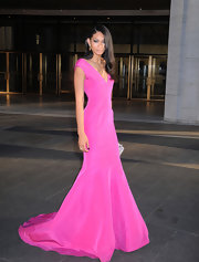 Chanel Iman chose a vibrant purple gown with a flared mermaid skirt for her look at the American Ballet Spring Gala.