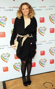 Kimberley Walsh chose a belted black wool coat for her preppy and classic look at 'The Health Lottery' event.