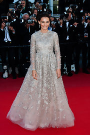 Saadet Aksoy was a vision in a light gray long-sleeve gown that featured a full tulle skirt and embroidered appliques all over.
