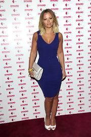 Kimberley Walsh put her hourglass figure on show in a sleeveless blue bandage dress during the launch of 'Magician Impossible.'