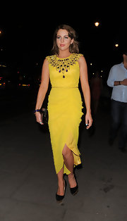 Lydia sported a chic yellow dress with Cleopatra-style jewel embroidery at the neckline.