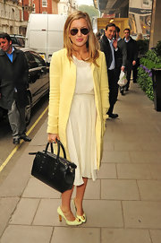 Caggie Dunlop wore a pair of summer-inspired pumps with gold button detailing.