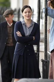 Natalie looks very sophisticated in her layered look.  Her look is very polished with her pulled back hair, skinny belt and pleated knee length skirt.