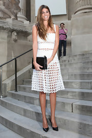 Bianca showed just a touch of skin when she donned this sheer, laser cut dress at the Giambattista Valli show.