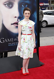 "Maisie Williams chose a fun, age-appropriate floral frock for her red carpet look at the ""Game of Thrones"" premiere."
