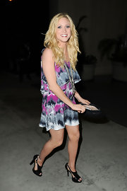 "Brittany took her printed dress from day to night with a pair of black patent leather ""Groove"" sandals."