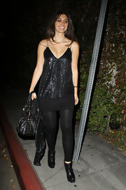 Brittney Gastineau chose sleek black ankle boots to wear with a black sequin tunic and sheer leggings.